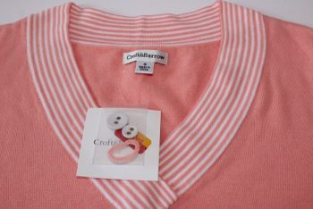 Women's blouses and dresses often come with small plastic bags attached to the tag. And in these bags you can find spare buttons