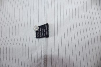 Men's shirts usually come from stores with spare buttons. You can locate them inside your garment.