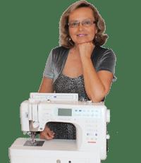 Image of Olga Balasa with a sewing machine