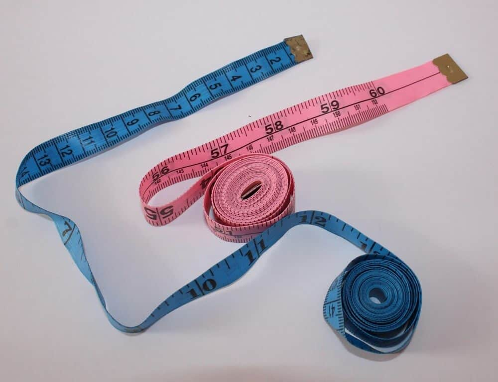 A measuring tape is usually a 150 cm (60 in) long tape made of a strong, non-stretch material, with metal rivets at the ends.