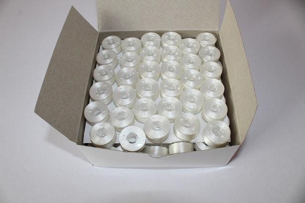 box of pre-wound bobbins