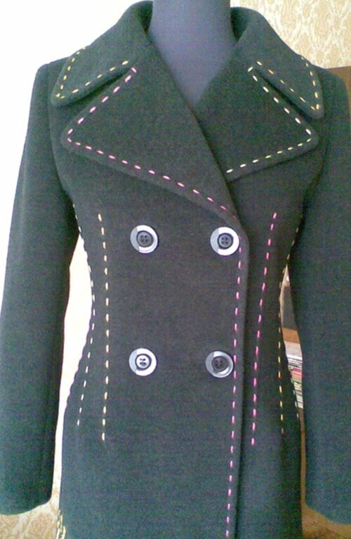 Jacket decorated with a running stitch