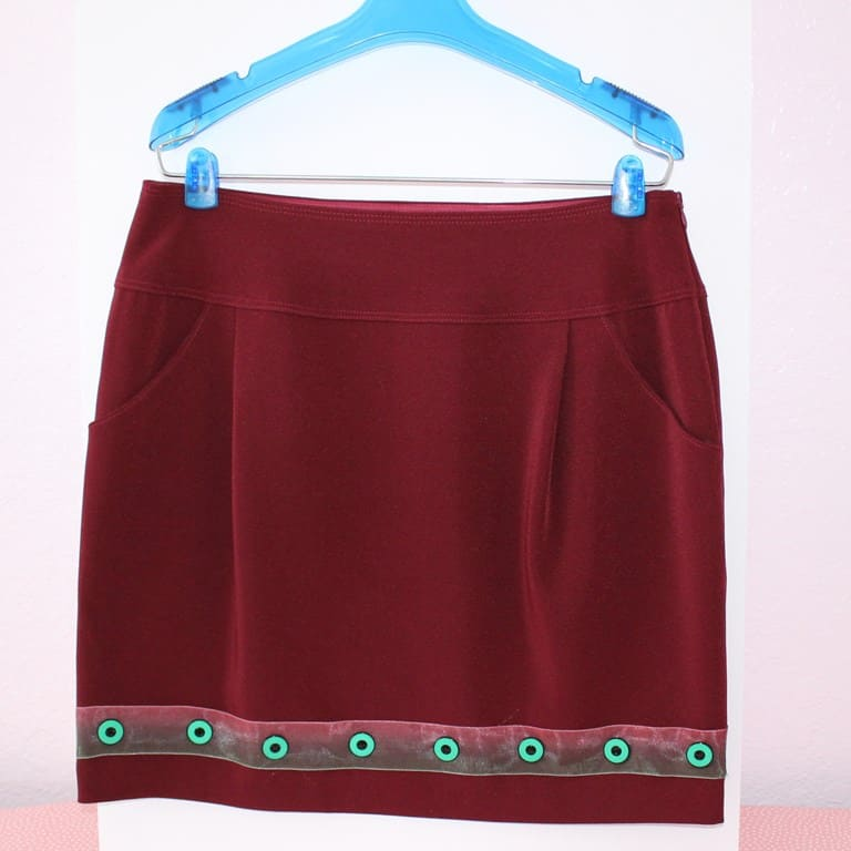 Skirt with button embellishment