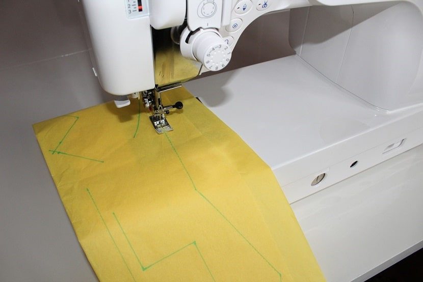 It is easier to learn how to sew exactly along the lines if you first start to sew on paper