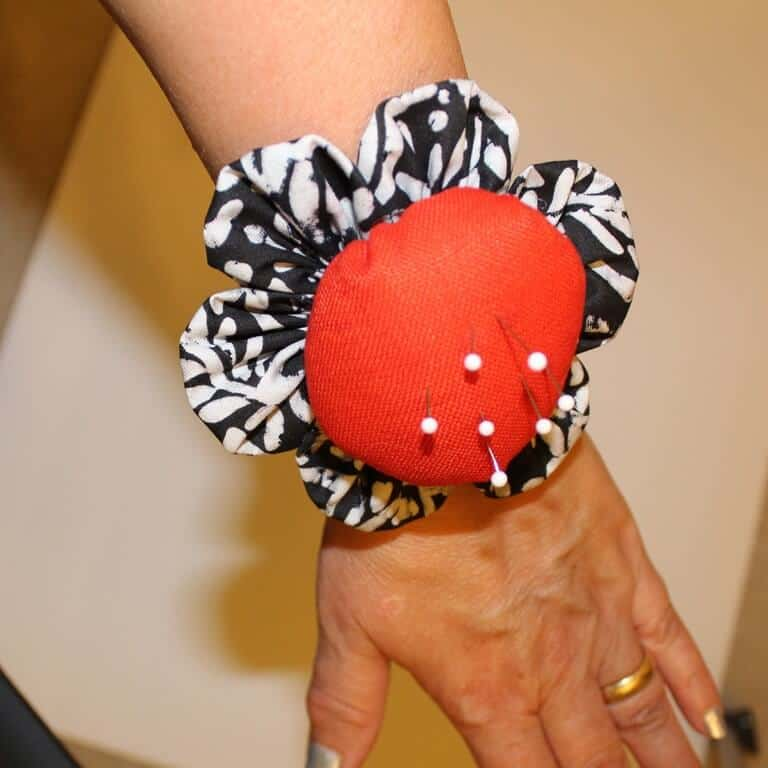 I recommend to make a wrist pincushion. I found it to be very useful!