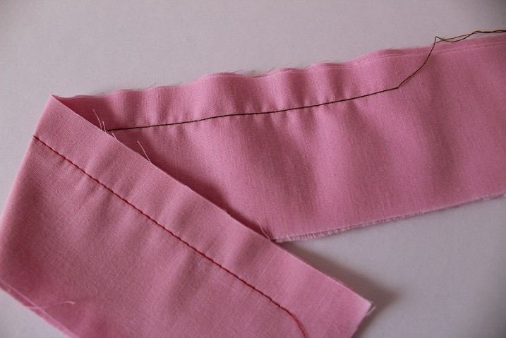 Do you see the loops of bobbin thread on the top side of the fabric and the fabric is slightly puckering on the top side?