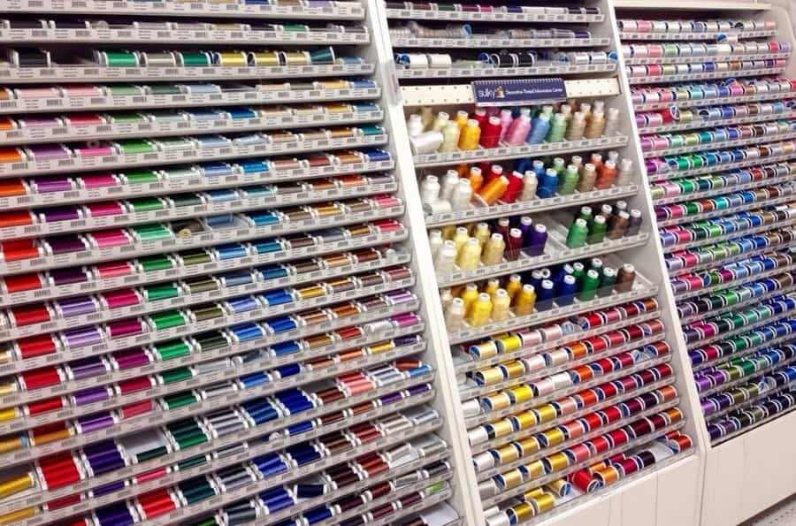 sewing threads in a fabric store on racks