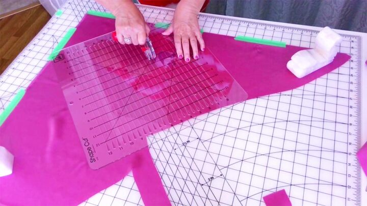 using a special ruler to cut fabric