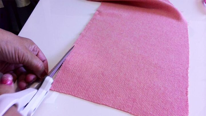 cutting the fabric by pulling a thread