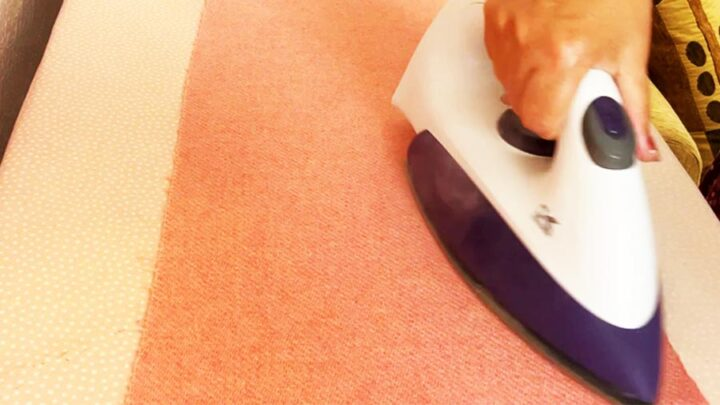 using steam iron to prepare wool flannel for the project