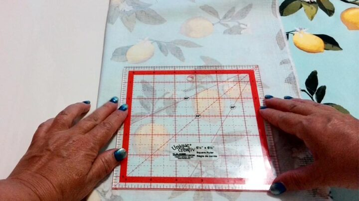 using a square ruler to cut pockets for the maxi dress